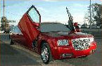 Chauffeur stretched red Chrysler C300 Baby Bentley limo hire with Lamborghini doors in Birmingham, Coventry, Dudley, Wolverhampton, Telford, Walsall, Stafford, Worcester.