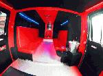 Chauffeur driven Fire Engine red limousine interior with real firemen for hire in London, Essex, Kent, Surrey Hampshire, Berkshire, Hertfordshire, Buckinghamshire, Suffolk, Norfolk, Cambridgeshire, Bedfordshire and East of England.