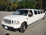 Chauffeur stretched white Ford Excursion 4x4 limo hire in UK