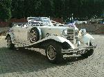 Chauffuer driven white Beauford wedding limo in Sheffield, Rotherham, Yorkshire, Doncaster, Huddersfield, Leeds, Scunthorpe, Nottingham and Derby.