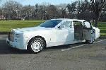 Chauffeur stretched Rolls Royce Phantom limo in white, silver or grey with suicide doors available in East of England, Peterborough, Huntingdon, Stanford, King's Lynn, Norwich, Great Yarmouth, Lowestoft, Wisbech, Spalding, Cambridge, Cambridgeshire, Bedford, Bedfordshire, Newmarket, Bury St Edmunds, Suffolk, Norfolk, Lincolnshire, Northampton, Northamptonshire, Kettering, Leicester and Sudbury.