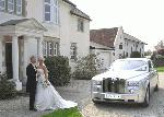 Chauffeur stretch Rolls Royce Phantom limousine in white, silver or grey with suicide doors available in East of England, Peterborough, Huntingdon, Stanford, King's Lynn, Norwich, Great Yarmouth, Lowestoft, Wisbech, Spalding, Cambridge, Cambridgeshire, Bedford, Bedfordshire, Newmarket, Bury St Edmunds, Suffolk, Norfolk, Lincolnshire, Northampton, Northamptonshire, Kettering, Leicester and Sudbury.