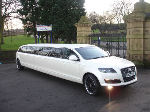 Chauffeur stretch silver Audi Q7 limo hire in Nottingham, Derby, Leicester, Birmingham Leeds, Bradford, London, Nottinghamshire, Derbyshire, West Yorkshire, South Yorkshire Midlands.