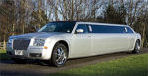 Chauffeur stretched silver Chrysler C300 Baby Bentley limo hire in Glasgow, Edinburgh, Scotland.