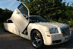 Chauffeur stretch cream Chrysler C300 Baby Bentley limousine hire with Lamborghini doors in Birmingham, Dudley, Wolverhampton, Telford, Walsall, Stafford, Worcester.