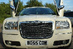 Chauffeur stretched cream Chrysler C300 Baby Bentley limo hire with Lamborghini doors in Birmingham, Dudley, Wolverhampton, Telford, Walsall, Stafford, Worcester.