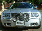 Chauffeur stretched silver Chrysler C300 Baby Bentley limousine hire in Sheffield, Rotherham, Doncaster, Chesterfield, South Yorkshire.