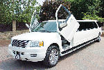 Chauffeur stretched white Ford Excursion 4x4 limo hire with Lamborghini doors in Sheffield, Rotherham, Barnsley, Doncaster, Huddersfield, South Yorkshire.