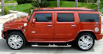 Chauffeur stretch burnt orange Baby Hummer H2 limousine hire in London, Berkshire, Surrey, Buckinghamshire, Hertfordshire, Essex, Kent, Hampshire, Northamptonshire