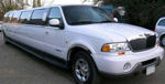 Chauffeur stretch white Lincoln Navigator limo hire in UK