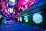 Chauffeur driven Party Bus limo hire interior in Bristol, Gloucester, Cheltenham, Cardiff, Wales, Weston Super Mare, and Bath.